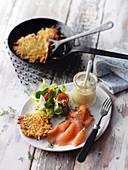 Smoked salad with fried Swiss potato cakes and salad
