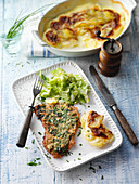 Veal escalope with a herb coating with pointed cabbage and potato gratin