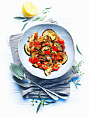 Eggplants with peppers and onions
