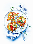 Spelt and potato pancakes with tomatoes and feta cheese