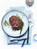 Flambéed pepper steak with rosemary