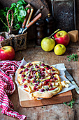 Pizza with brie, cranberries and apple
