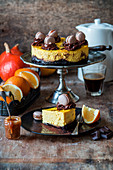 Pumpkin and orange cheesecake with a brownie base and macarons