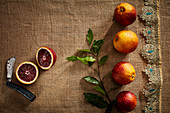 Blood oranges, whole and halved