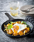 Curried hash with sunny-side eggs