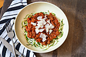 Zucchini noodles with bolognese sauce and parmesan
