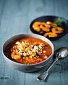 Greek rice and seafood soup with feta