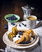 Pancakes with blueberries, grilled bananas and yoghurt