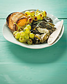 Baked feta with roasted grapes