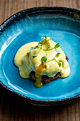 Smoked trout hash, asparagus, poached egg and hollandaise