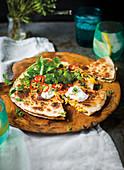 Quesadillas with sour cream and cilantro