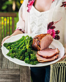 Roast ham with a ginger beer and Sriracha honey glaze, served with broccolini