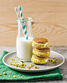 Ice cream sandwiches with ginger ice cream and pistachios