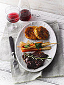 Bison ragout with potato cakes and root vegetables