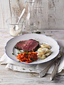 Beef fillet with herbs, gnocchi and a carrot dip