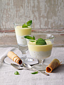 Welfencreme (creamy wine sauce dessert) with spiral-shaped wafer rolls
