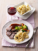 Marinated roast lamb with Spätzle (soft egg noodles from Swabia)