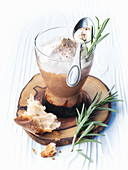 Foamed wild mushroom soup in a glass