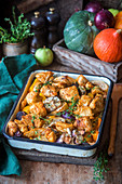 Roasted chicken breast with pumpkin, apple and onion
