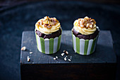 Vegan chocolate cupcakes with vanilla frosting and caramelised almonds