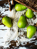 Green pears and basket