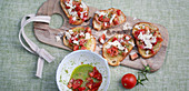 Tomato bruschetta with pesto and Parmesan cheese