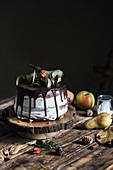 Chocolate and pear cake on wooden table