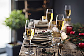Champagne glasses on christmas table setting