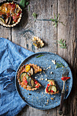 Vegetarian pastry tarts in a rustic kitchen