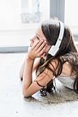 10 years old child listening music