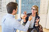 Woman trying prescription glasses