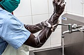 Surgeon washing his hands