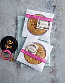 Cookies packaged in personalised CD envelopes as gifts