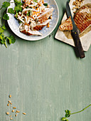 Turkey steaks on a celeriac and carrot salad with oranges