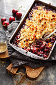 Grilled cherry crumble with liquorice and white chocolate