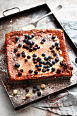 Grilled macadmaia nut cake with chocolate cream and blueberries