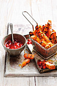 Grilled sweet potato fries with spiced sugar and strawberry ketchup