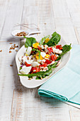 Dandelion salad with hard-boiled eggs and sunflower seeds