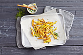 Oven chips with a cashew nut and herb dip