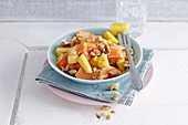 Papaya and pineapple salad with walnuts for breakfast