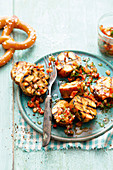 Grilled pretzel dumplings with tomato vinaigrette