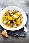 Grilled fish stew with root vegetables