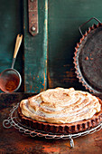 Grilled nougat rum tart with vanilla meringue