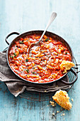 Grilled spicy beans and bacon with cornbread