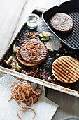 Burger with braised onions and gherkins