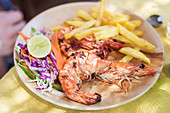 King prawns with red cabbage and fries (Galgibag beach, South Goa, India)