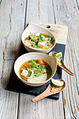Asian vegetable soup with rice noodles and tofu