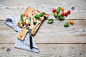Mediterranean pizza with basil and cherry tomatoes