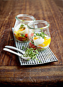 Eggs in glasses with avocado salsa