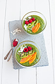 Green smoothie bowls with papaya and kiwis